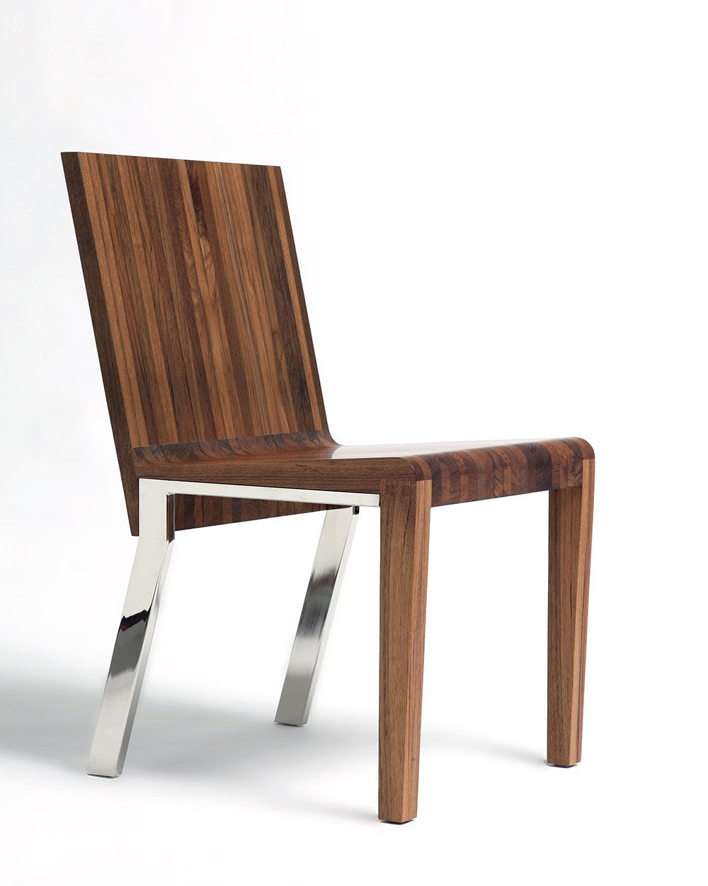 Custom chair shown at angle, metal legs, wood.