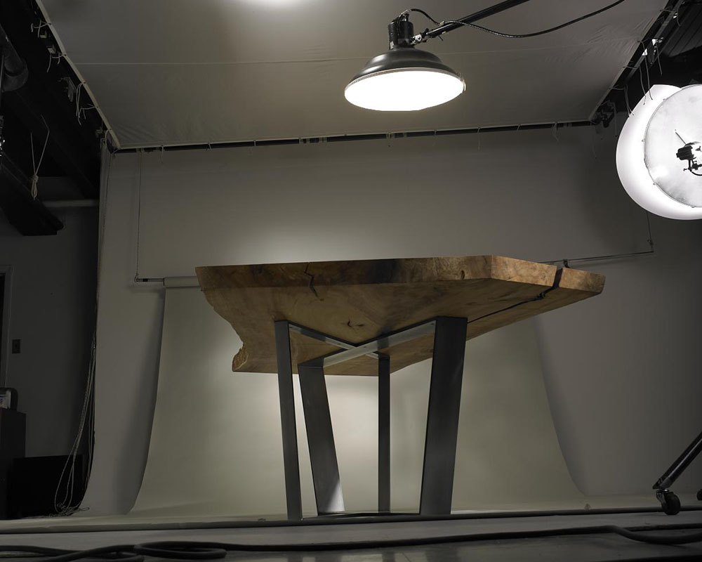 Custom dining table shown in photography studio.