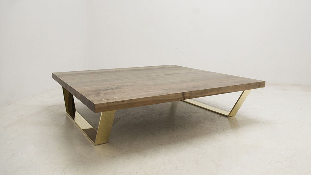 Custom extra-large coffee table - maple table top with polished brass legs.