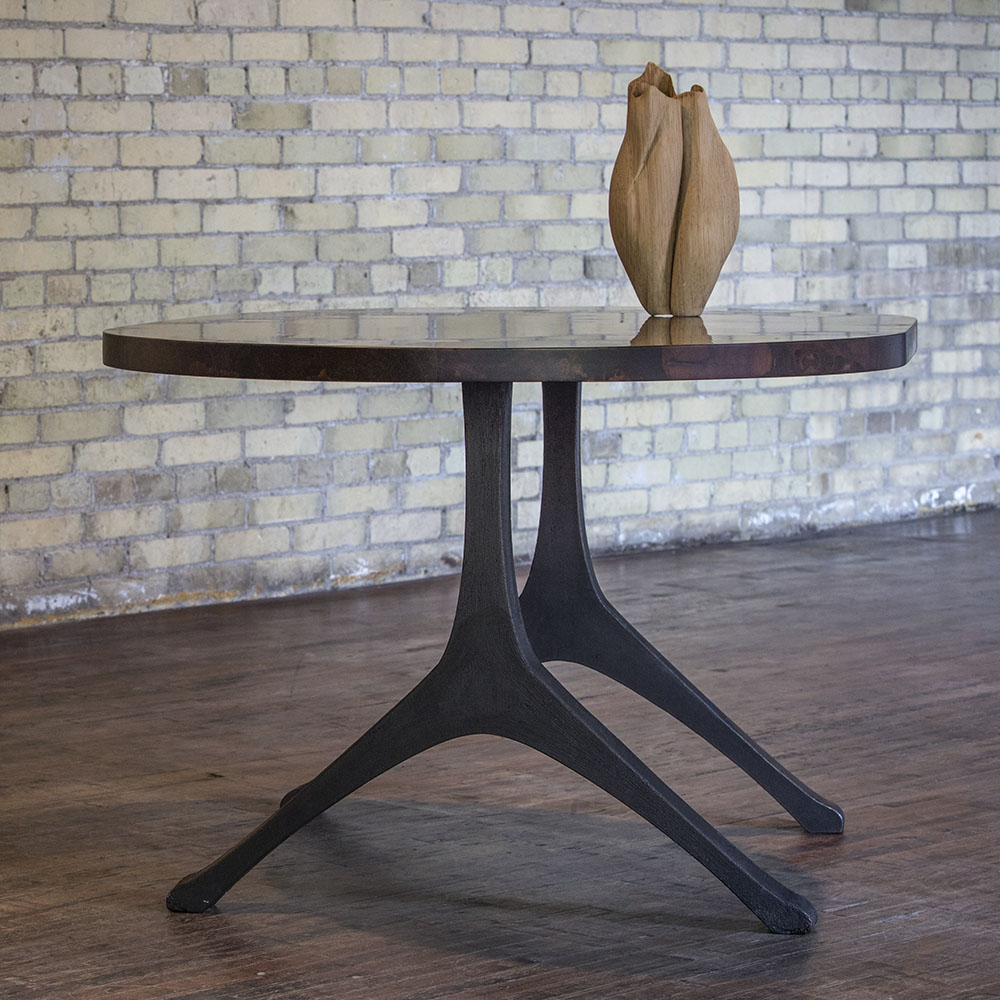 Custom oval table in industrial loft style setting. Shown with wooden vase.