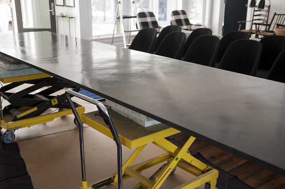 Installation of custom 13.5' dining table, designed and fabricated by STACKLAB in Toronto, Canada.