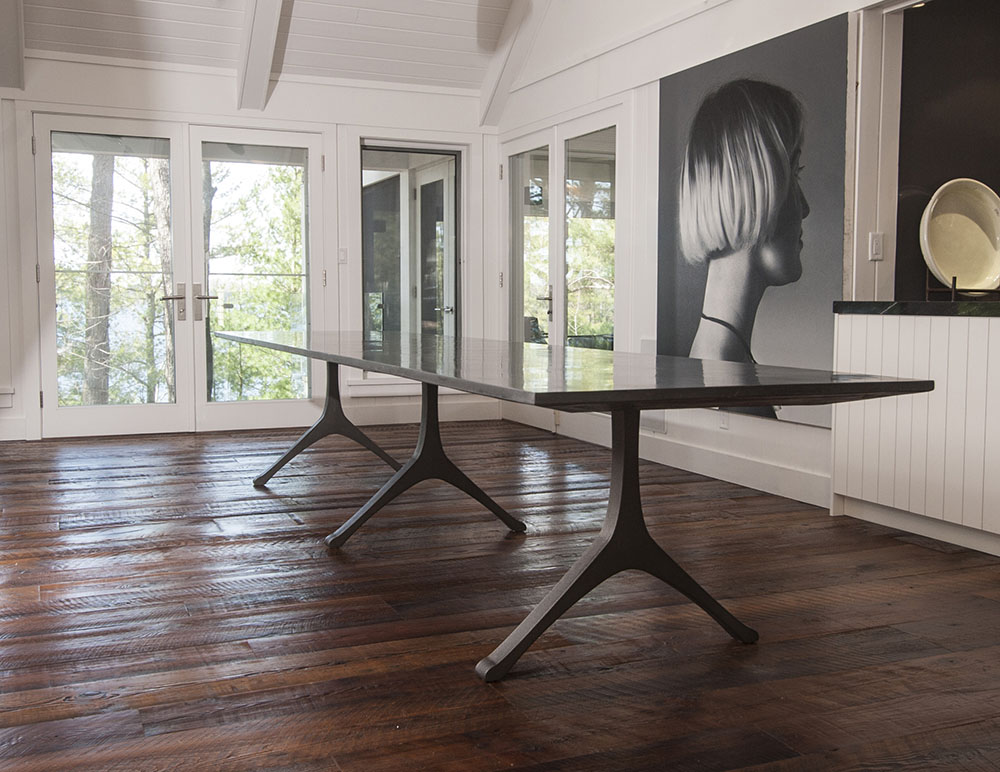 Custom extra large black dining table - Engineered Cementitious Composite table top paired with cast-iron legs.