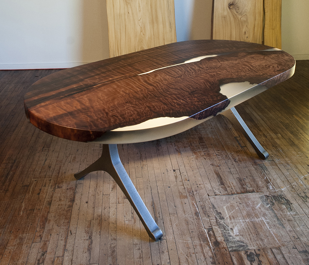 Oval Cut Burl table made out of redwood, clear resin and iron legs.
