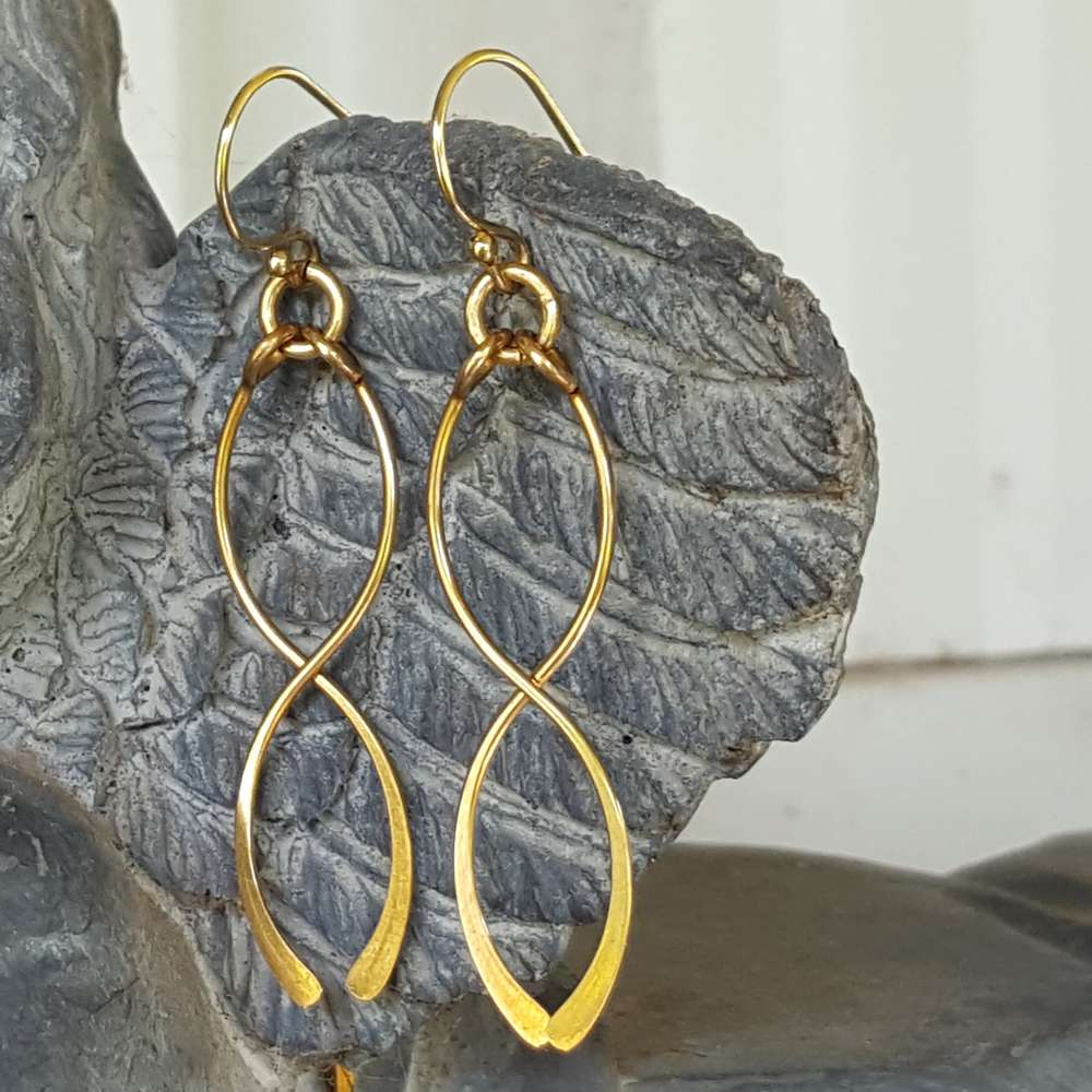 gold-infinity-fragile-x-earrings-close-up