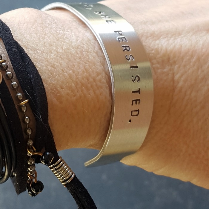 nevertheless-she-persisted-aluminum-bracelet-on-model