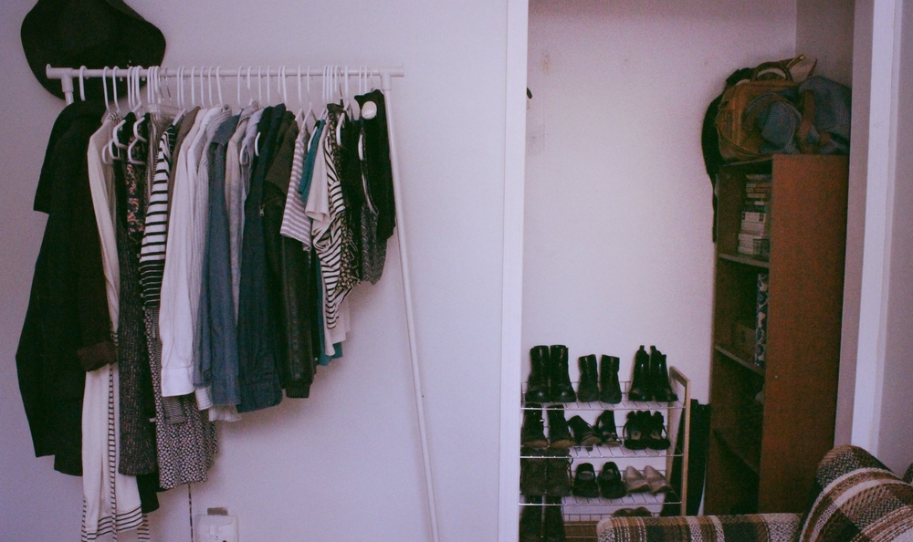 clothing rack with jackets, robe, skirts, dresses, & tops