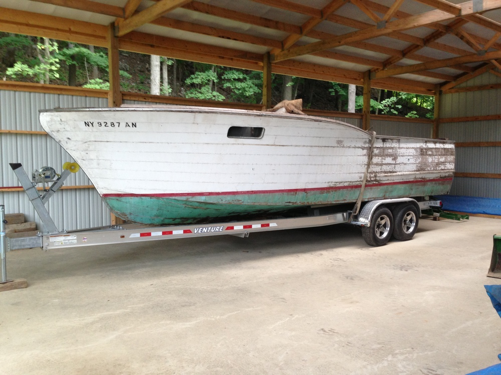 Justin and Keri Fasulo's 1957 Chris Craft Sports Express being prepped for restoration.