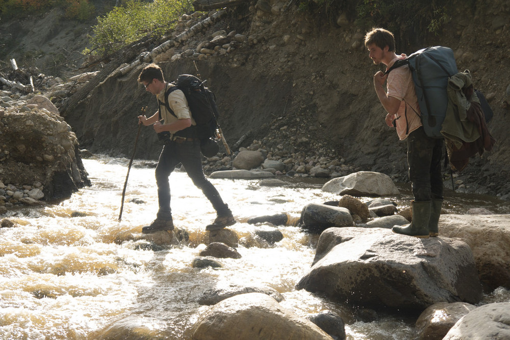 Mitch and Nate navigating the river rocks on a mission to stay dry.