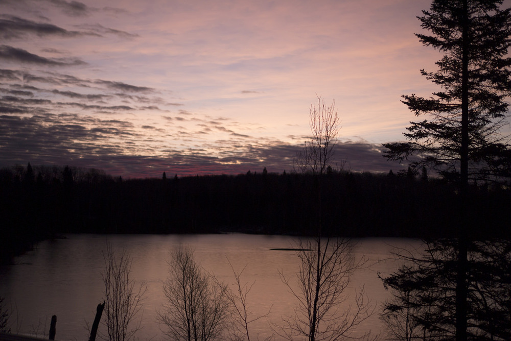 Sunrise over Moose Lake from the shelter's loft.
