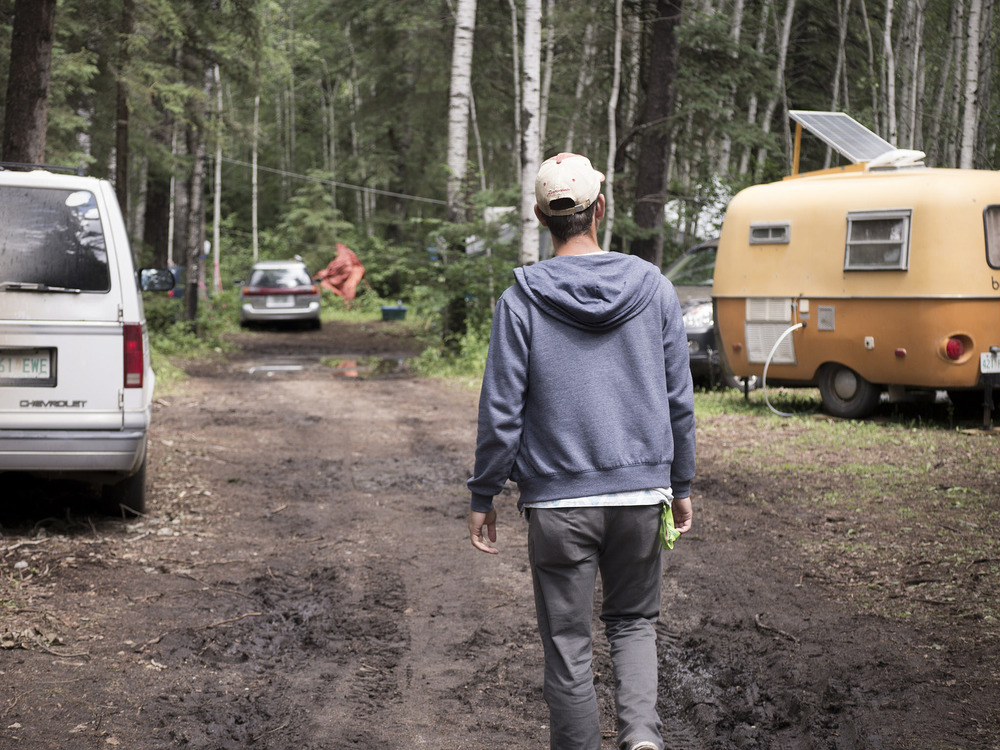 Walking through campgrounds packed with trailers and tents.