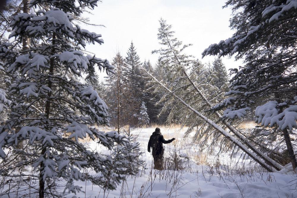 Hiking through snow at Duck Mountain