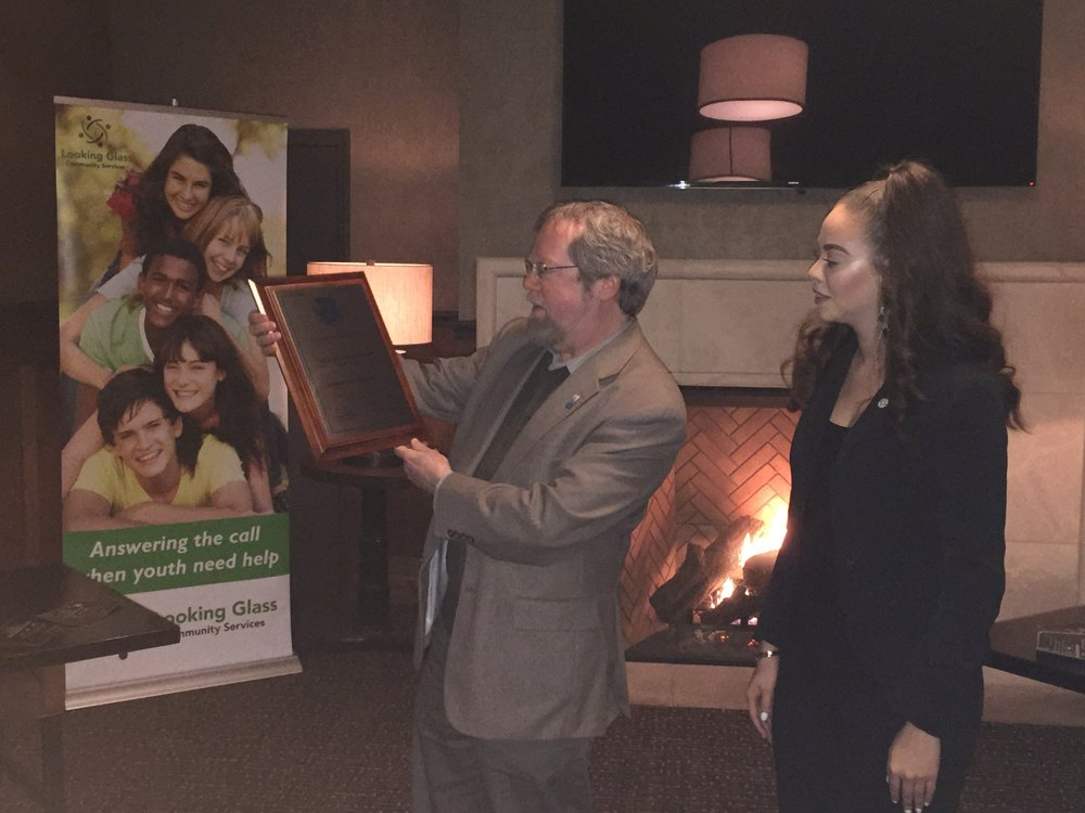 Looking Glass CEO, Craig Opperman, and Executive Office & Quality Assurance Coordinator, Kierstin Dunavant, admire the COA award plaque during the award announcement at a small gathering of supporters, board members, staff and donors at  Oregon Electric Station  on Wednesday, February 28th 2018.