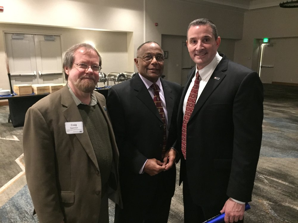 From left: Looking Glass CEO Craig Opperman, Looking Glass board member and United Way Alton F. Baker award recipient George Russell and Looking Glass board president Dan LaCoste celebrate together at United Way of Lane County's annual awards banquet on Wed, March 7th 2018.