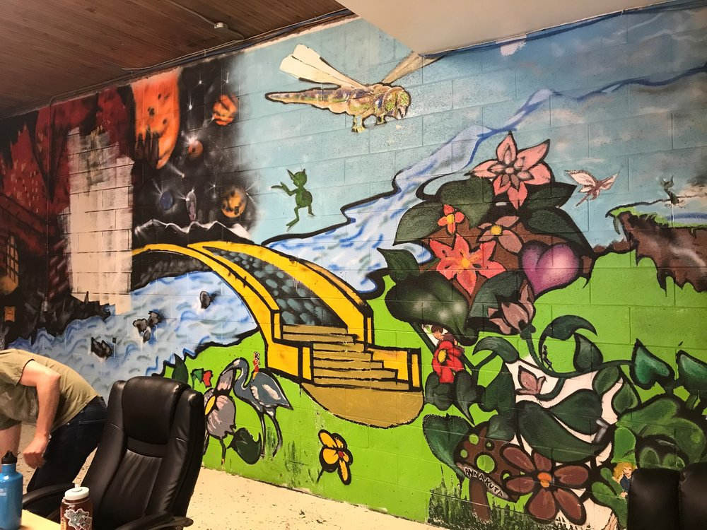 The previous wall mural (above) was painted in 1995 at Pathways Girls.