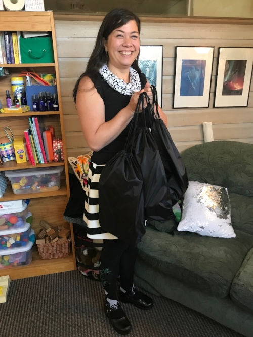 Therapist Carlyn Wierda shows off a few of the remaining Self Care Kits. Dozens have already been distributed to our youth clients.