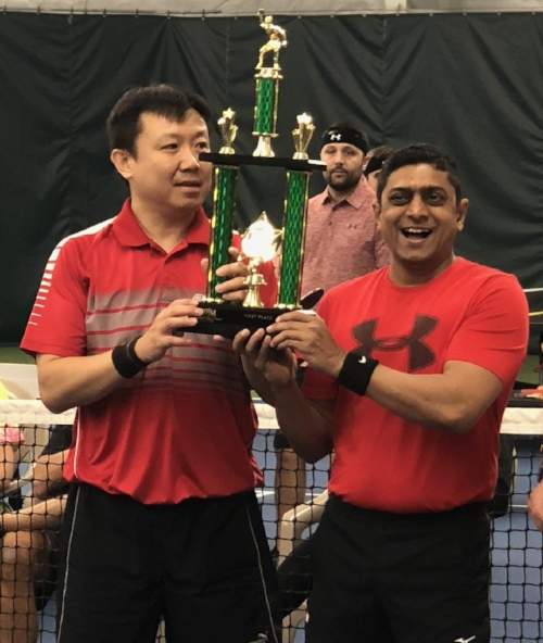 Paddle Battle 2018 Champions Tian Wei Chen (left) and Samir Patel embrace their 1st place trophy after their hard fought victory over team Ping Pow!