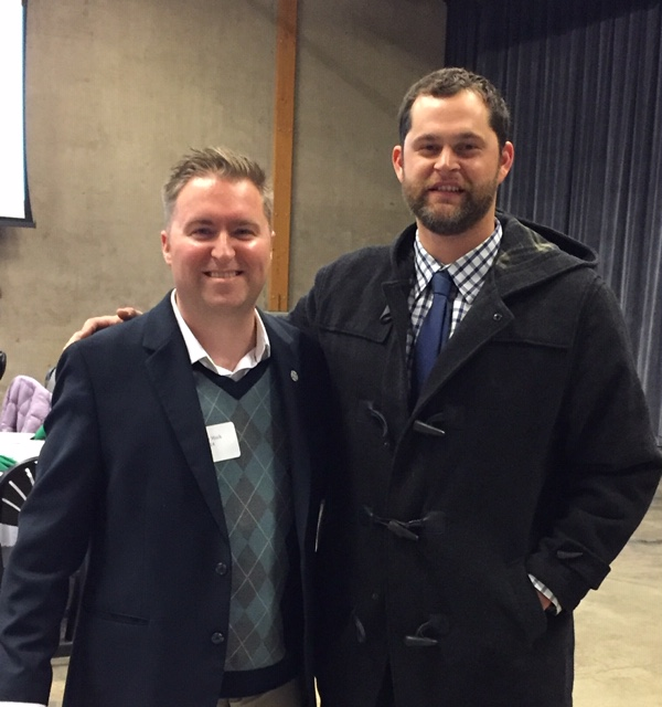 Looking Glass Marketing & Development Director, Tyler Mack (left), and Looking Glass Board of Stewards member and supporter, Luke Jackson pose for a photo after the breakfast event.