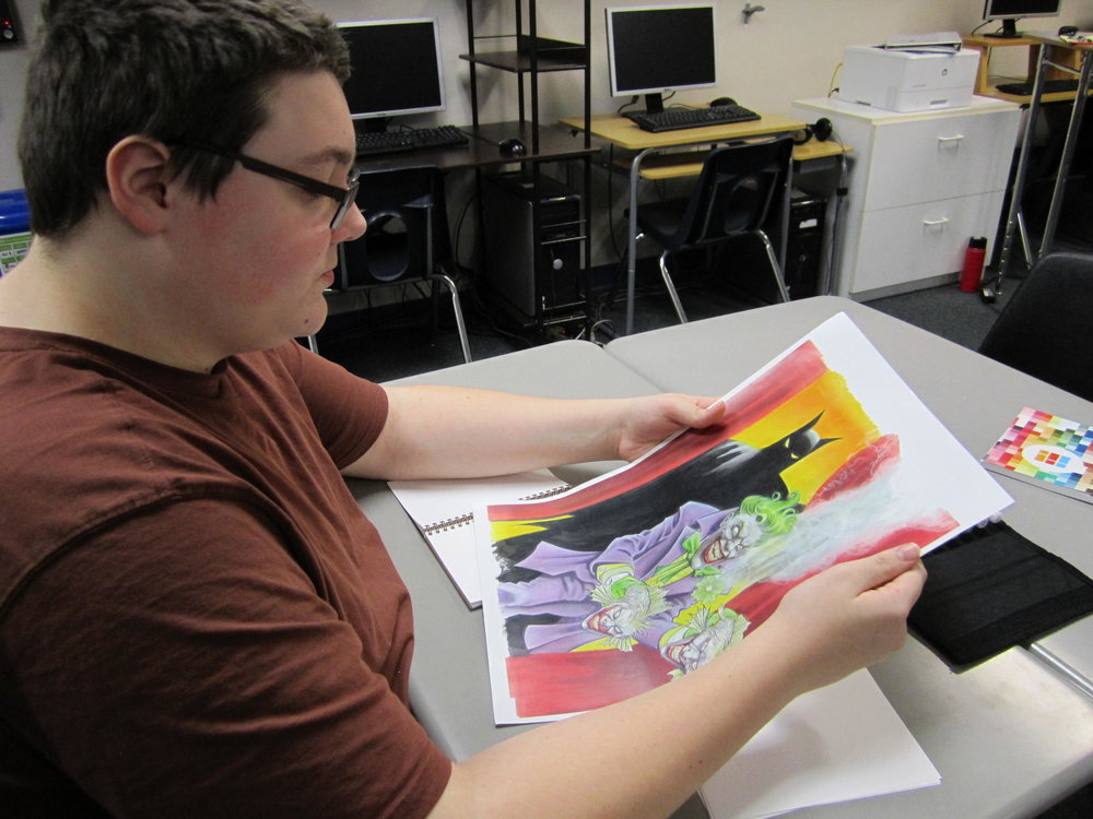 A Center Point student looks, in awe, at art work done by Matt Brundage.