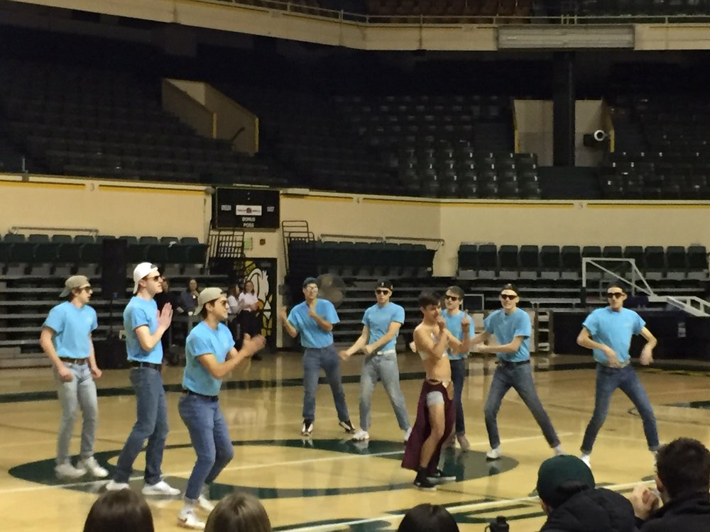 A UO fraternity group performs at the Shamrock event.