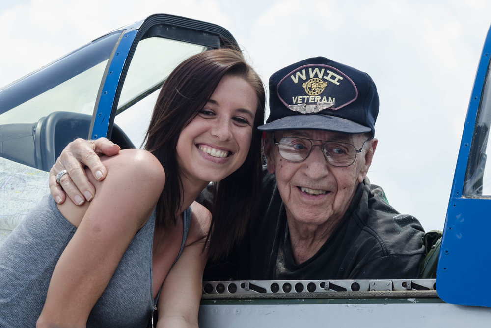 "Lt. Goebel posing with one of the lovely young ladies in attendance ""Once a Fighter Pilot always a Fighter Pilot"""