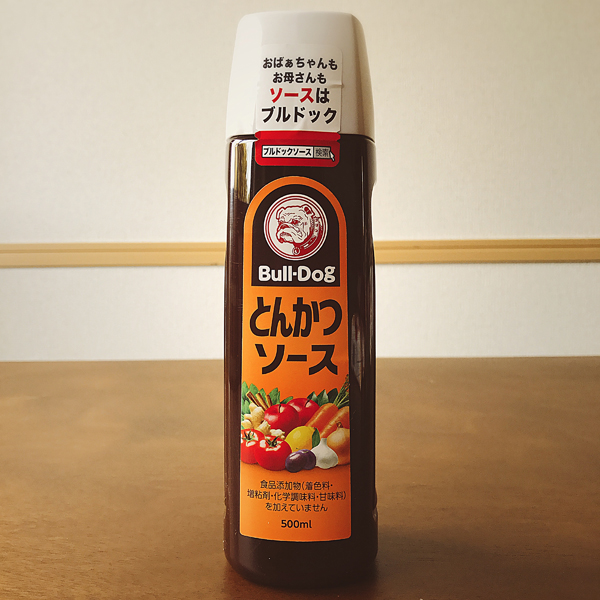 "とんかつ ソース - Tonkatsu sauce - ¥ 308 Yuuuuuuuuuum. Bulldog makes a few sauces, but this ""vegetable and fruit"" sauce (that's what it's made with, not what you put it on) is their original bestseller. Tonkotsu is pork bone and Americans usually hear it in reference to pork bone broth; tonkatsu is pork katsu (fried cutlet). Tonkatsu sauce is a ""Japanese Worcestershire-style sauce"" marketed chiefly as a topping for pork katsu, but served with a variety of savory foods. I am not fond of pork, but this sauce is so so tasty that I will eat it on any breaded fried meat, drizzled on a soft boiled egg with rice, or mixed into Japanese curry for extra flavor."