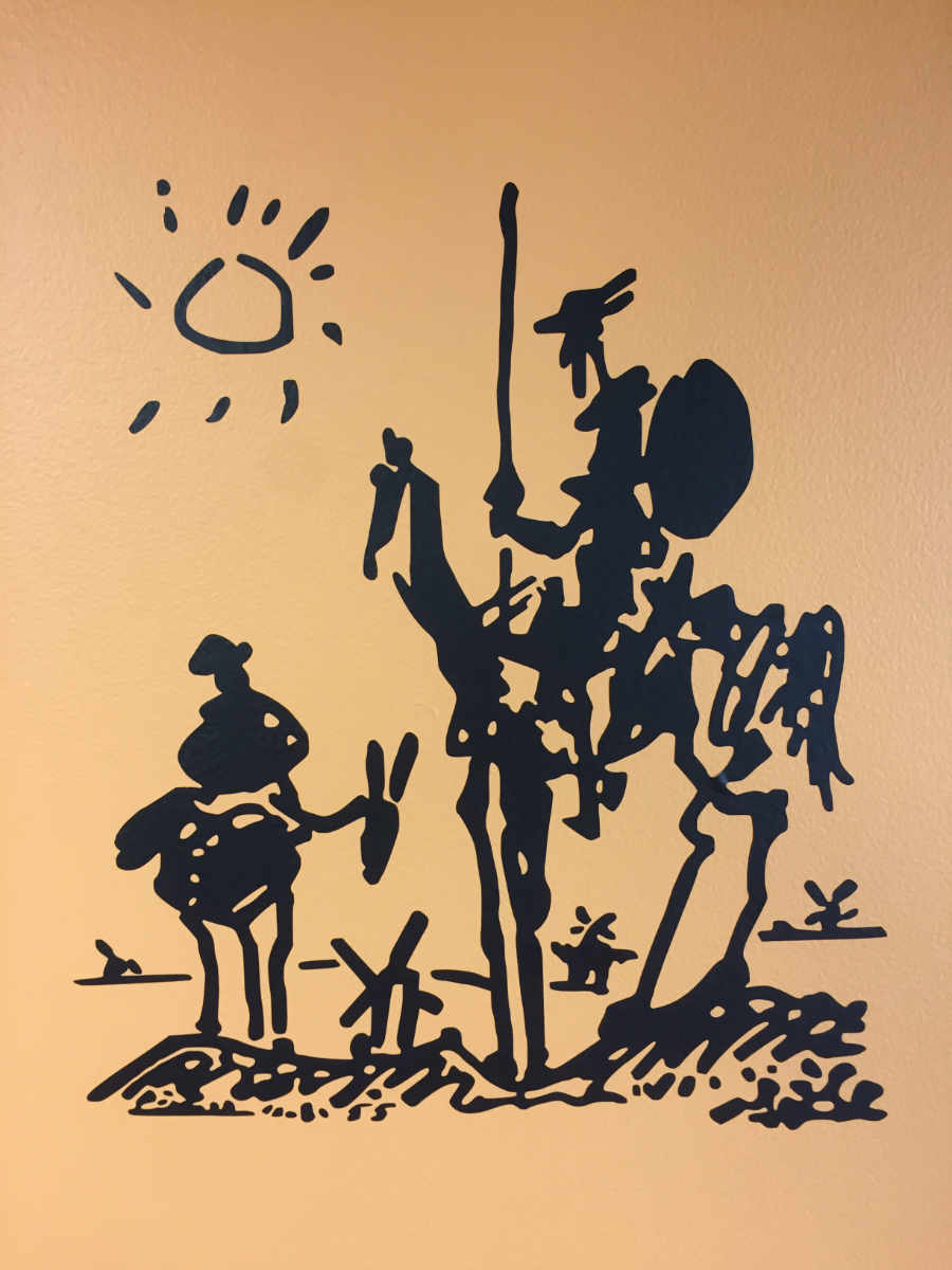 "Don Quixote. 18'h x 12""w (Easy to apply)  Black graphic on orange wall."