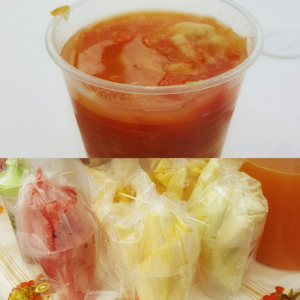 Top: Fresh fruit juice made with mango, banana, and papya  Bottom: Fresh sliced fruit mango and watermelon available for sale, try the mango with lemon juice and salt