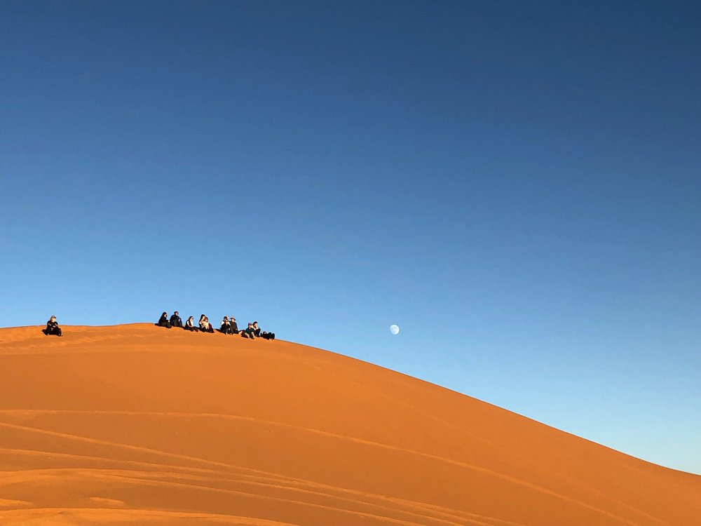 Taking a break on the sand dunes in Morocco