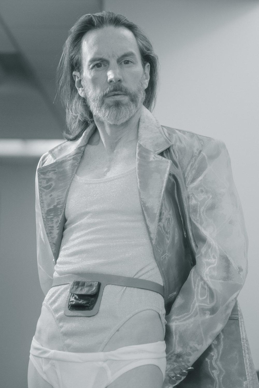 Timothy wears coat Vasilis Loizides, vintage DKNY bodysuit James Veloria, belt Nat Carlson and underwear Hanes.