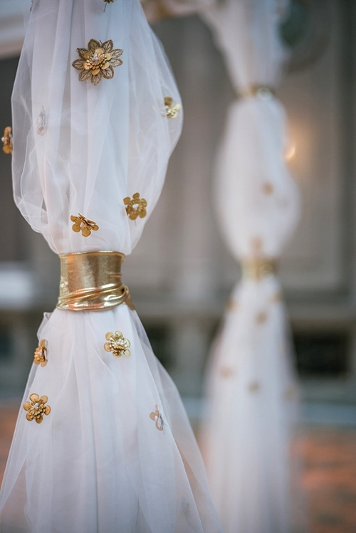 As you get close up, more details come in to view like handpainted gold leather flowers. It is important that the chuppah look great from both close up and far away.