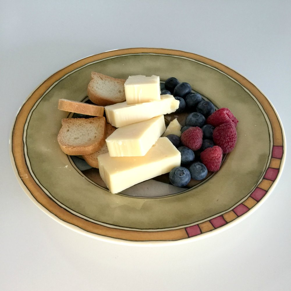 Option – cheese plate assortment with crackers and fresh berries