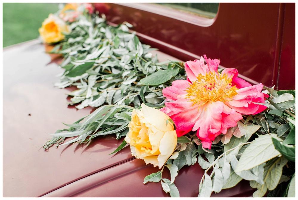 florals_on_vintage_car_Potomac_on_the_river_venue_Navy_wedding_Natalie Jayne Photography_image