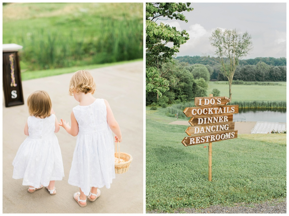 flower_girl_and_signs_Potomac_on_the_river_venue_Navy_wedding_Natalie Jayne Photography_image