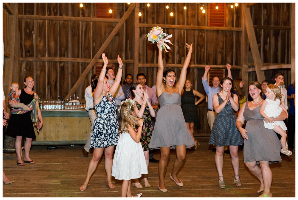 bouquet_toss_reception_Potomac_on_the_river_venue_Navy_wedding_Natalie Jayne Photography_images