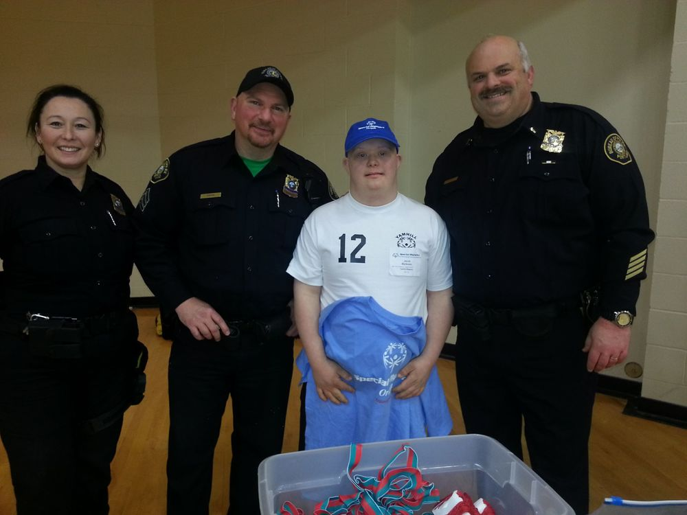 Jacob Beckmann assisting Portland Police at a Special Olympics Event.