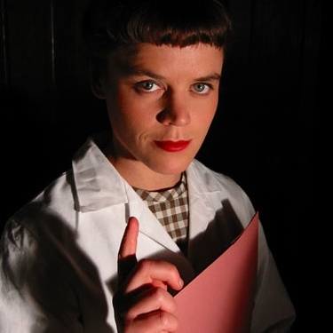 Gemma Brockis as Scientist in Tropicana