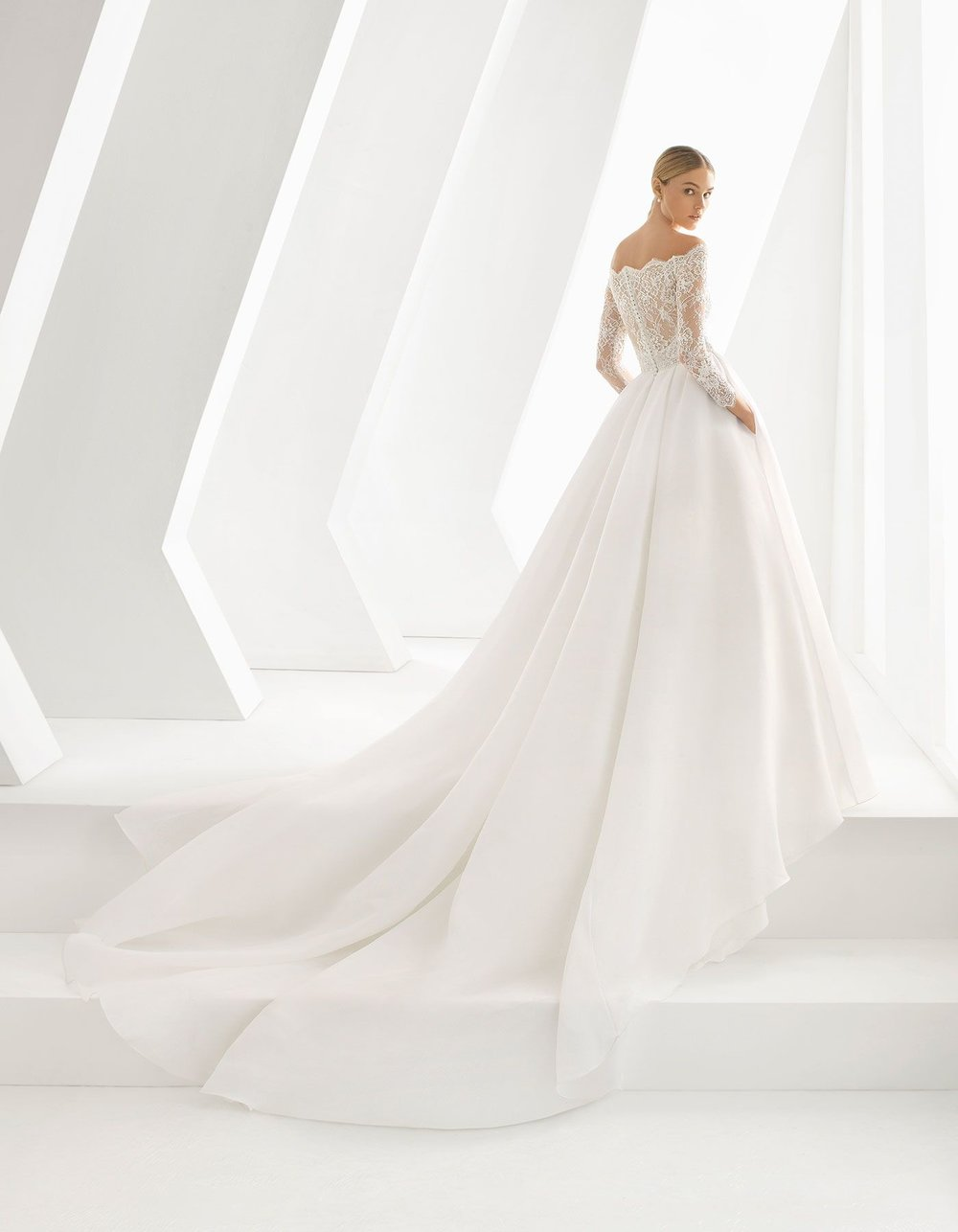 Rosa Clara Drake - this dress is a real show stopper! A princess gown with long sleeves and a scalloped neckline, finished off with a beautiful long train.