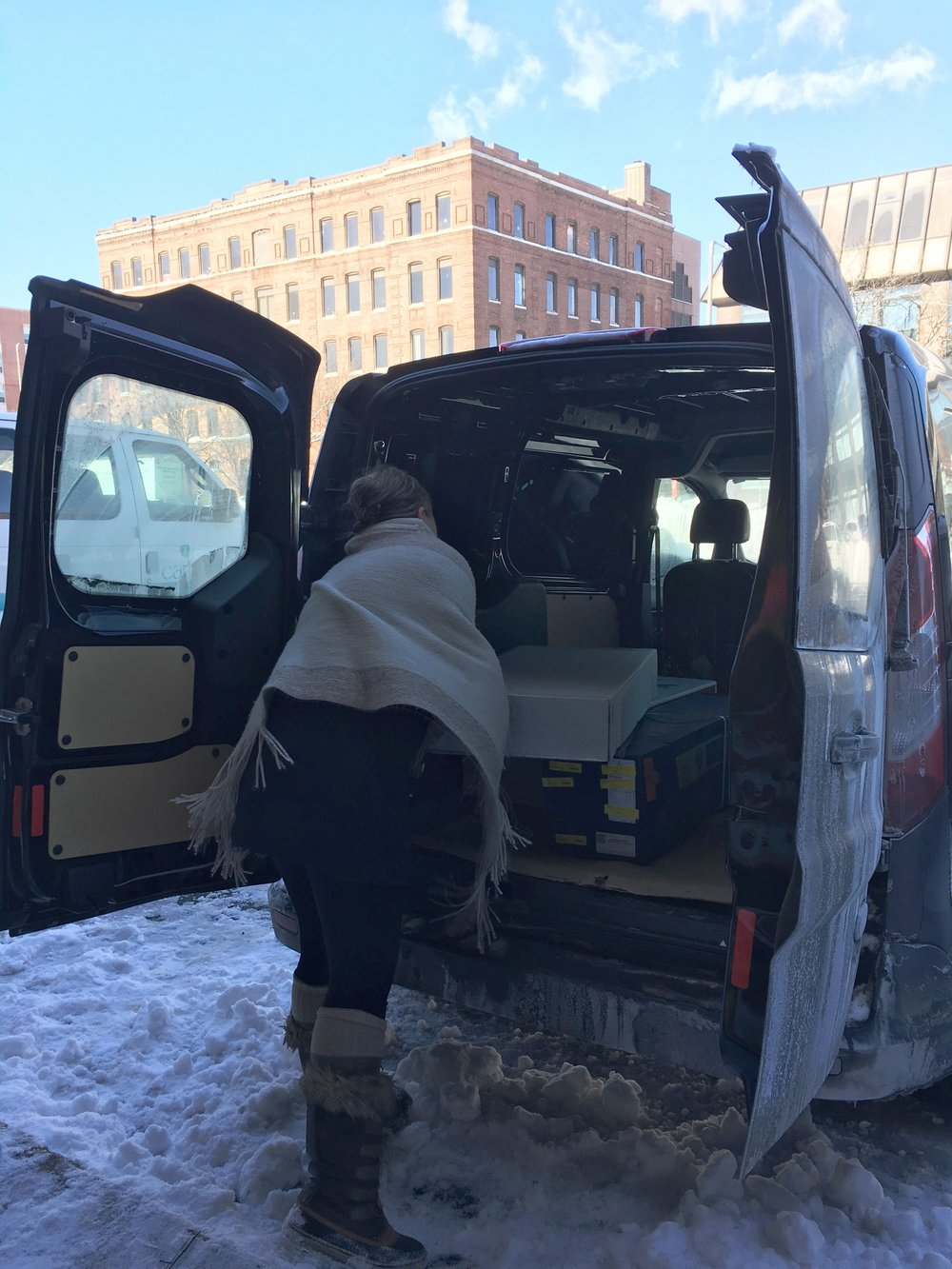 Emily Herzig loads fresh flowers into her van at the Boston Flower Exchange on a cold winter day. | Photo: Molly Donahue