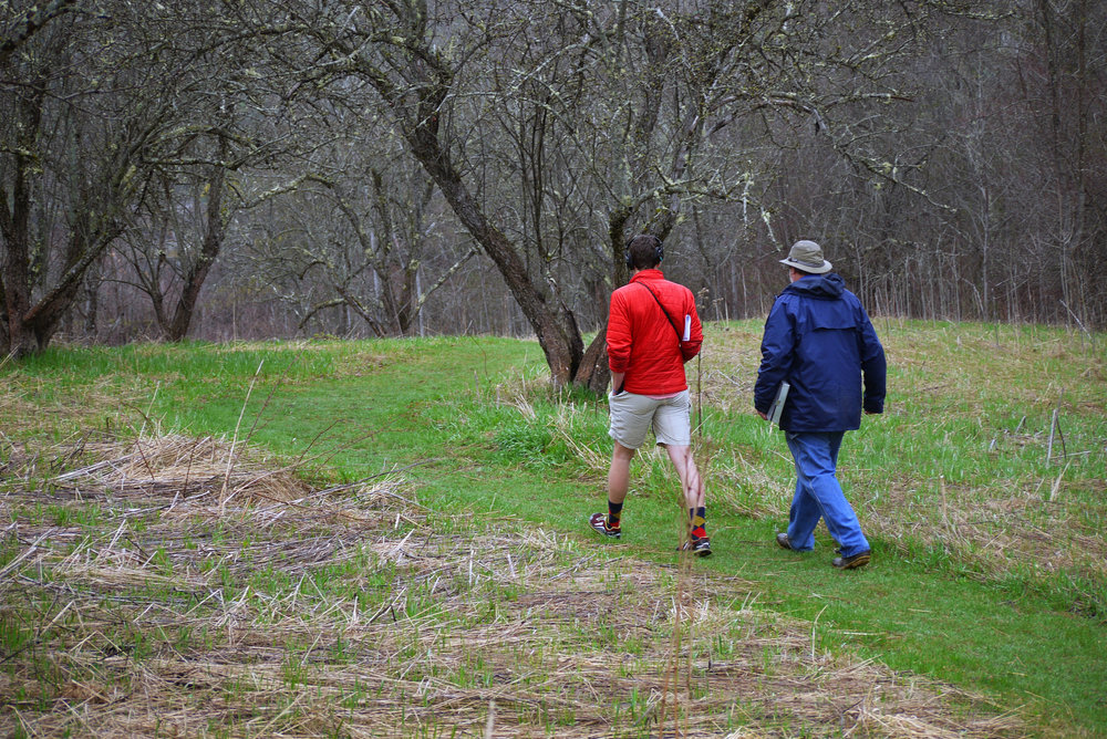 Sam Evans-Brown and Arthur Spiess walk down the path towards the Whaleback midden | Photo: Logan Shannon