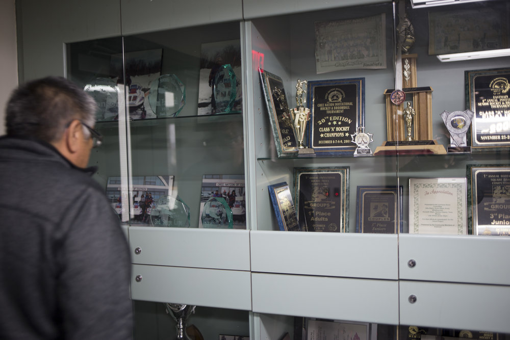 Kenny Gilpin looks for his photo in the trophy case at the Eastmain Community Center