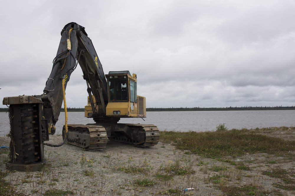 A bulldozer by the river in Eastmain