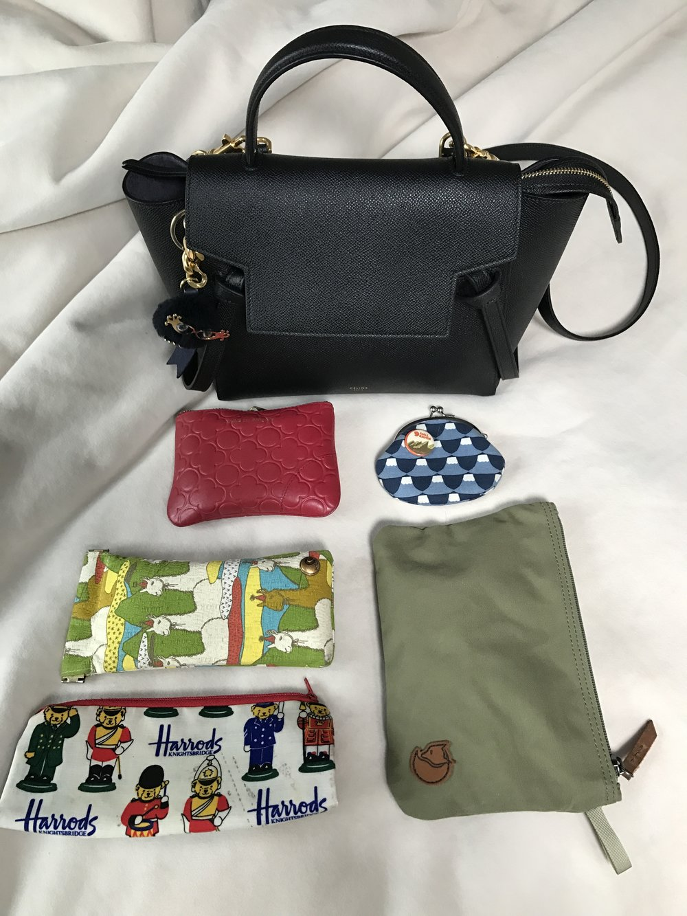 My usual daily items in my bag (wallet, coin purse, sunglasses, and several pouches for essentials)