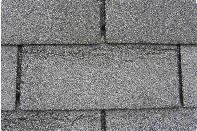 Wind creased shingles, such as this photo, cannot be seen from the ground