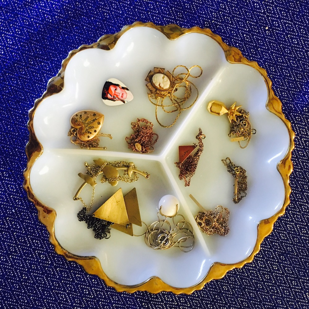 This vintage serving tray was a steal at $19. It has enough space to hold all of my necklaces while avoiding tangles!