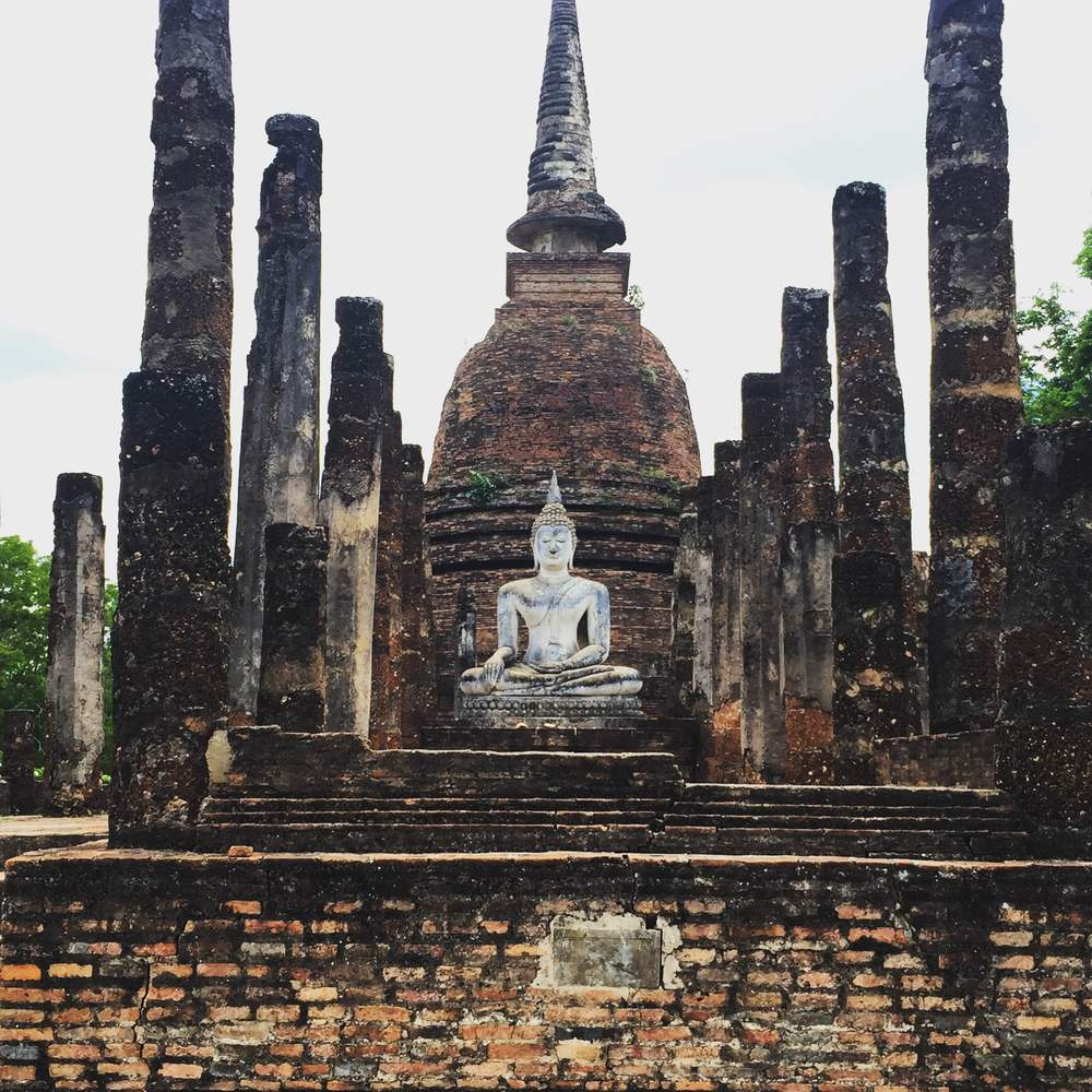 An incredible Buddha statue in the ancient ruins of Sukhothai.