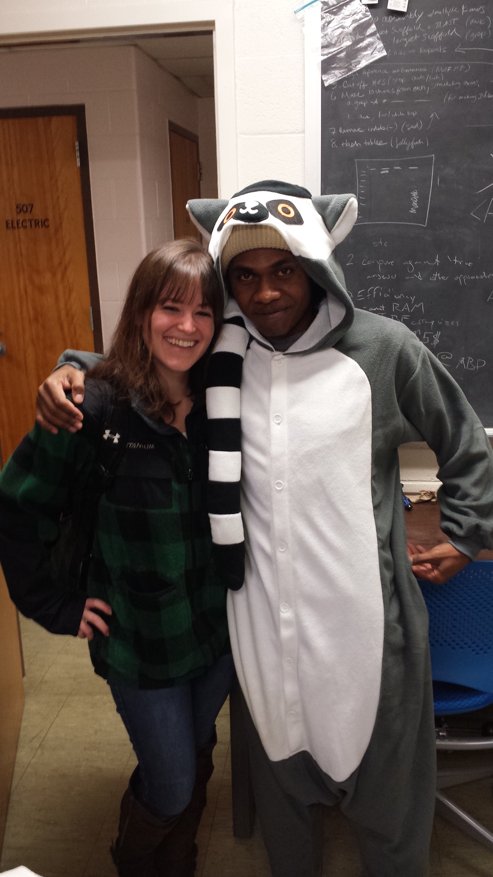 Graduate students Alexis Sullivan and Heritiana Randrianatoandro (as a ring-tailed lemur!) in their office.