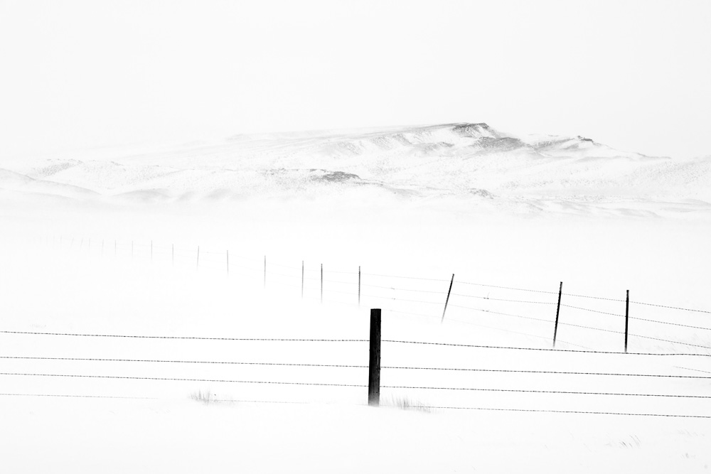 Fence Post and Hill During Ground Blizzard, Shirley Basin, WY  (Photo Credit: Chuck Kimmerle)