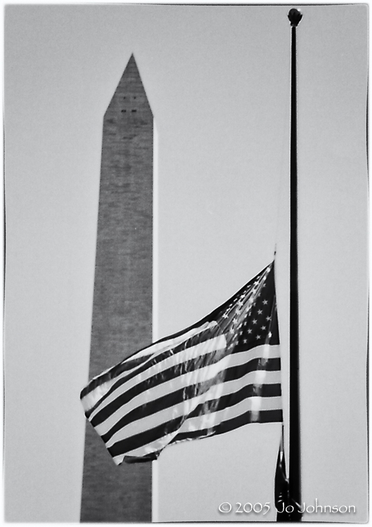 WWII Memorial Washington DC. The flag flies at half staff for Chief Justice William Rehnquist.
