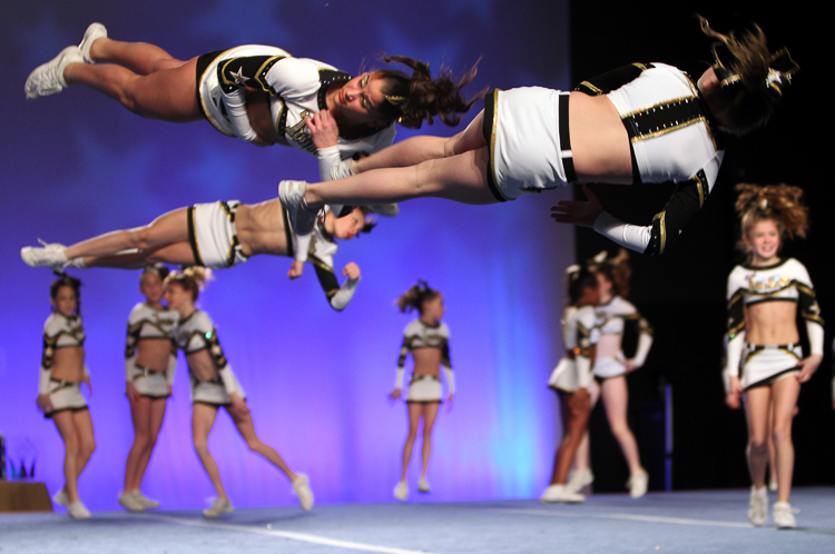 Tatiana Sykowski, top left, does her tumbling pass as the Twinkles compete in the Cheer for Charity at the Chase Center on The River Front in Wilmington, Delaware February 18, 2012.  (Photo Credit: Saed Hindash)