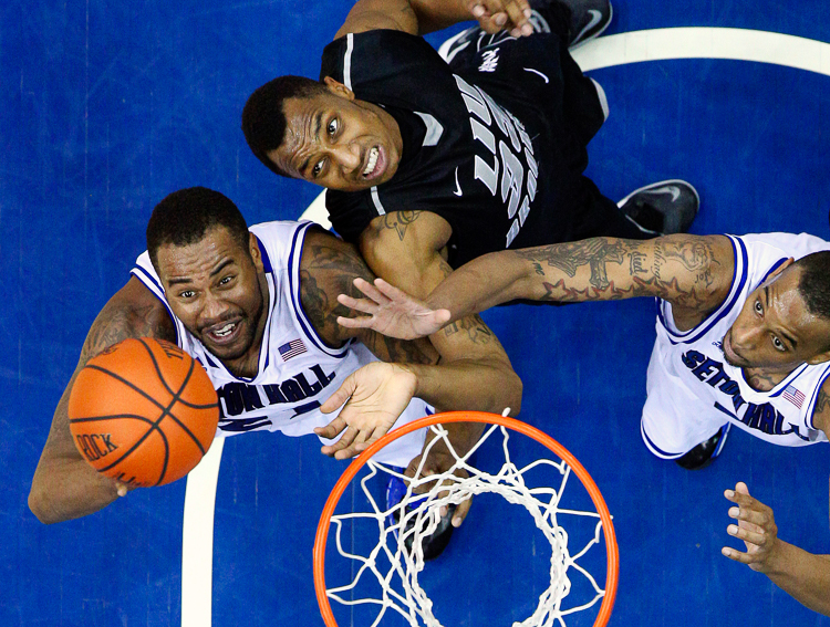 Seton Hall Pirates center Eugene Teague, left, and Seton Hall Pirates forward Brandon Mobley, right, battle Long Island Blackbirds forward E.J. Reed (33) for a rebound on Dec. 5, 2013, at the Prudential Center. Seton Hall defeated LIU, 92-81.  (Photo Credit: Saed Hindash)